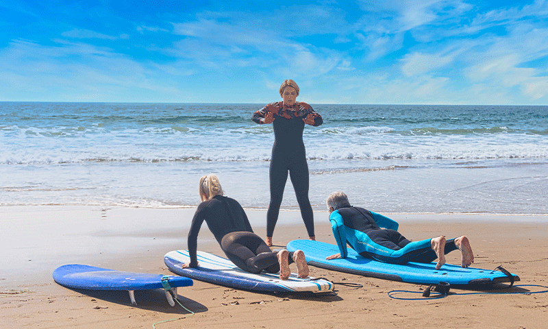 Two Clients and surf instructor doing surf therapy at The Pointe Malibu